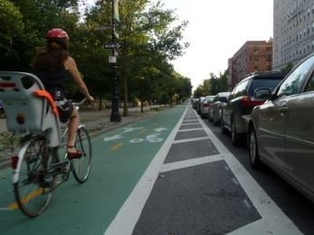 Women with Child Riding in the Bike Lane in New York